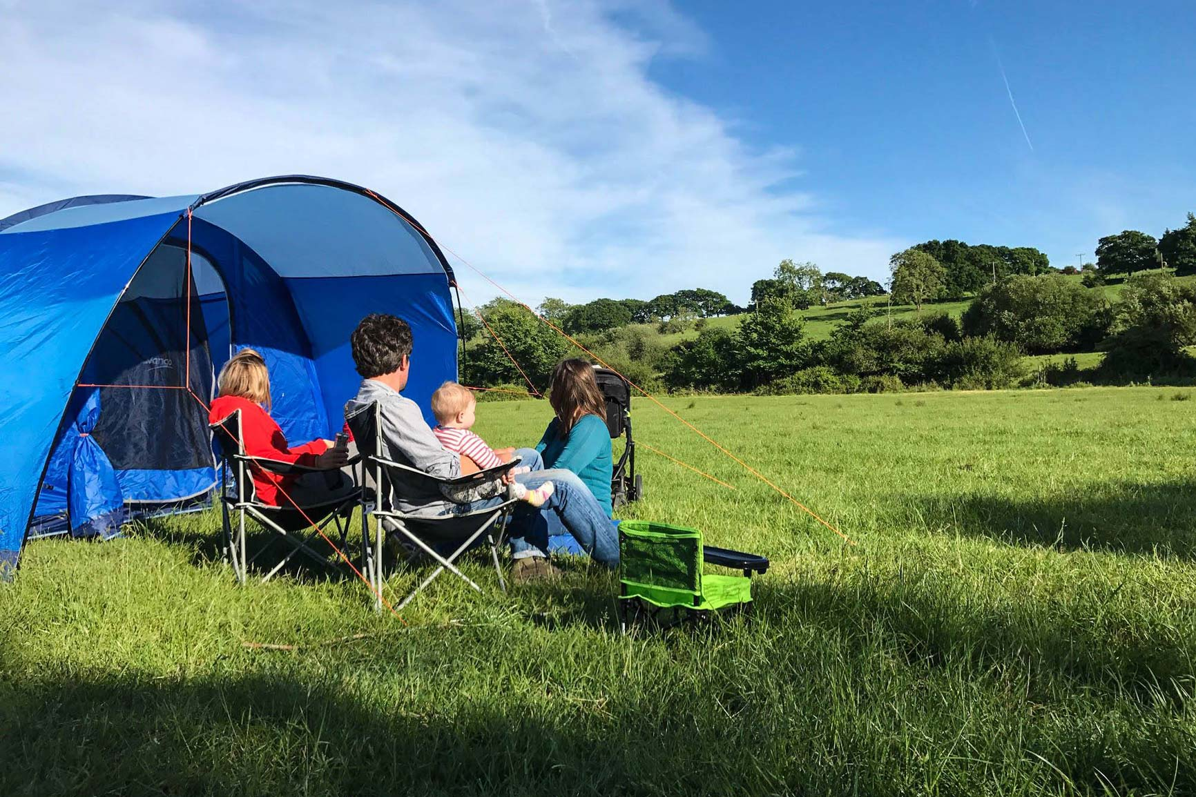 family camping in field at selden farm campsite